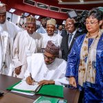 President Muhammadu Buhari signing the agreement establishing the African Continental Free Trade Area (AfCFTA), on behalf of Nigeria