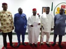 Chairman of the Forum and Governor of Ebonyi State, David Umahi (middle) reading the Southeast Governors Forum at the end of their meeting on Sunday in Enugu. He is flanked by other governors of the Forum