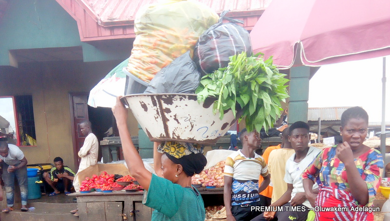 SPECIAL REPORT: Inside the lives of struggling 'alabaru' at Lagos markets - Premium Times