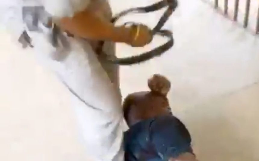 Man receiving beating from a local government chairman in Akwa Ibom State.