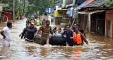 Monsoon Flood in India[PHOTO CREDIT:The Irish Times]
