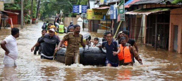 Monsoon Flood in India[PHOTO CREDIT:The Irish Times]