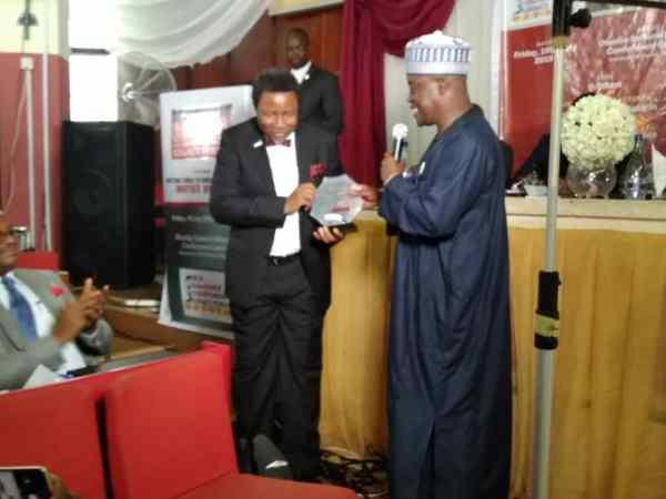 Mr Otolorin receiving Osotimehin's Award of excellence.