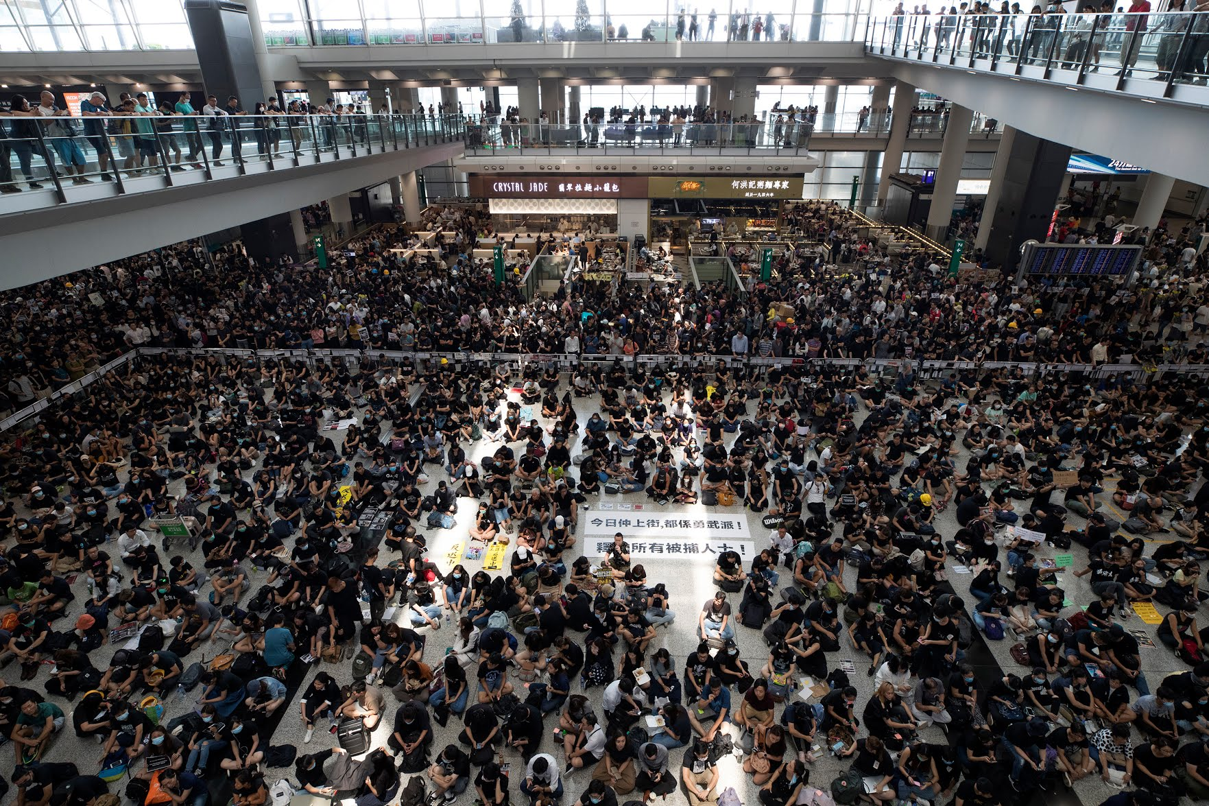Flight cancellations have now entered a second day at one of the world's busiest airports, prompting China to slam the protests as 'terrorism.'