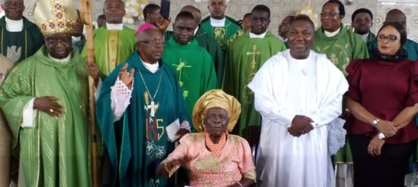 Enugu State Governor, Rt. Hon. Ifeanyi Ugwuanyi (2nd right) with his deputy, Hon. Mrs. Cecilia Ezeilo (right), Catholic Bishop of Awgu Diocese, Most Rev. John I. Okoye (left), Bishop Emeritus of the Catholic Diocese of Nsukka, Most Rev. Dr. Francis Okobo (2nd left), Bishop Okoye's Mother, Ezinne Janet E. Okoye (middle) and Priests of the Catholic Diocese of Awgu, during the Thanksgiving Mass for the Bishop's Mother, held at St. John's Pro Cathedral Church, Owelli, Awgu Local Government Area, yesterday.