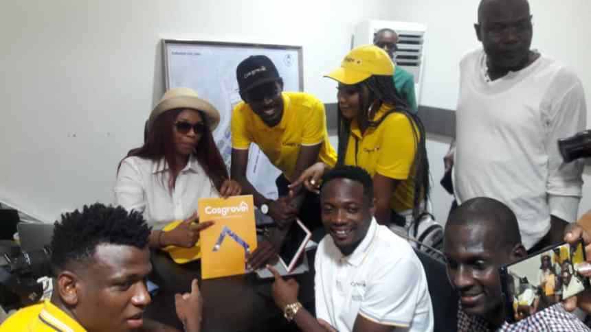 Super Eagles Captain, Ahmed Musa points to the brochure of Cosgrove Smart Estates shortly after it was presented to him by the Principal Marketing Officer of the company, Ochua Umoru, while his teammate Abdullahi Shehu (formerly of Kano Pillars) and members of the Cosgrove team look on, during the visit of the footballer and his entourage to the Maitama/Katampe site of Cosgrove in Abuja.