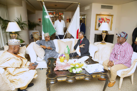 President Muhammadu Buhari chats with Minister of Foreign Affairs, Geoffrey Onyeama,  Nigerian Amnassadoe to Japan, Alhaji Mohammed Gana Yisa and Benue State Governor, Samuel Ortom an on arrival for the 7th Tokyo International Conference on African Development in Japan. PHOTO; SUNDAY AGHAEZE. AUG 26 2019.