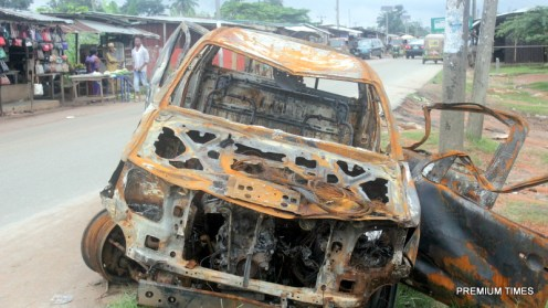 The burnt police truck. Photo by Patrick Egwu.