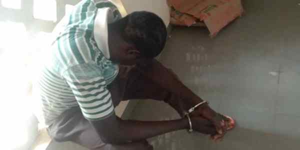 A suspected rapist, a gate man from Niger Republic handcuffed at the Sexual Assault Centre on Monday 26-8-2019