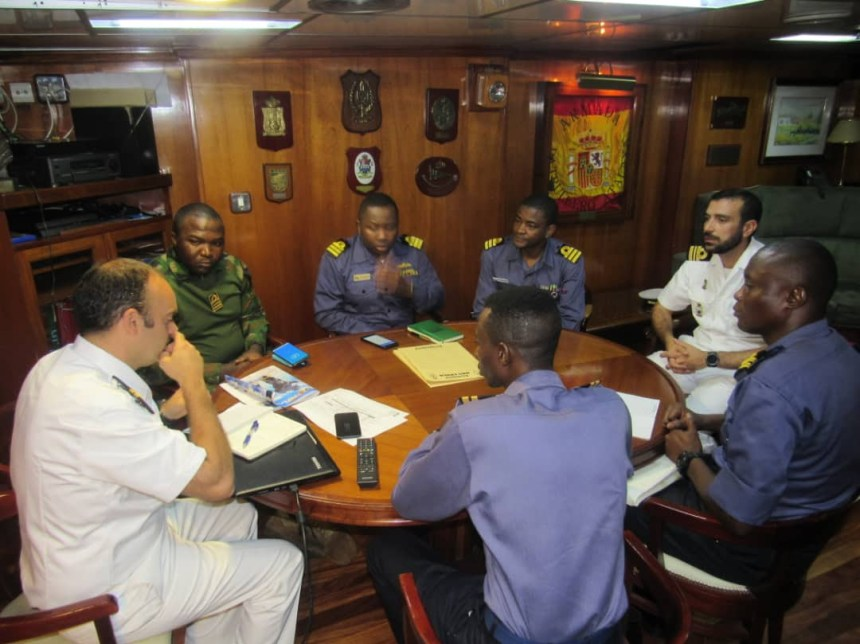 Some of Nigerian Navy officers and Spanish Navy officers exchanging notes