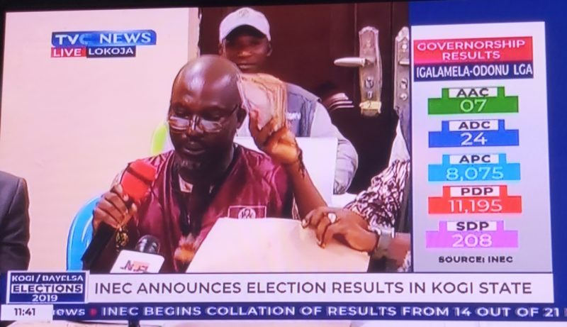 Electoral officer showing the bribe content on live TV[PHOTO CREDIT: TVC News]