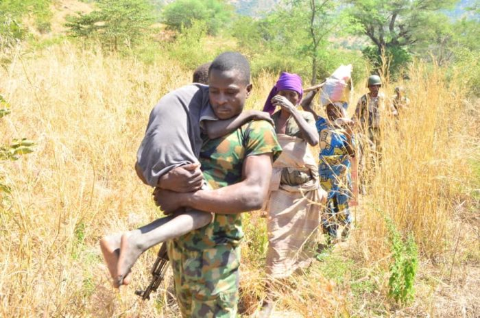 A Nigerian soldier leads victims rescued from Boko Haram captivity on Nov. 16, 2019