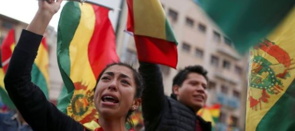 "Protesters chanted ""yes we could"" and ""Bolivia"" as they celebrated the resignation (Photo Credit: Reuters)"