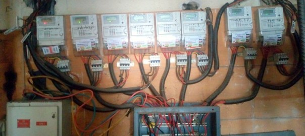 A switchboard of prepaid meters in an official building in Abuja.