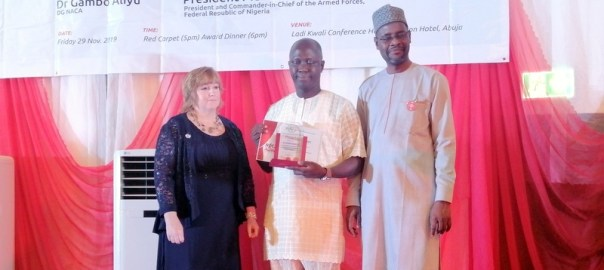 The managing editor of PREMIUM TIMES, Idris Akinbajo, receiving the award for the DG NACA and representative of the US ambassador to Nigeria