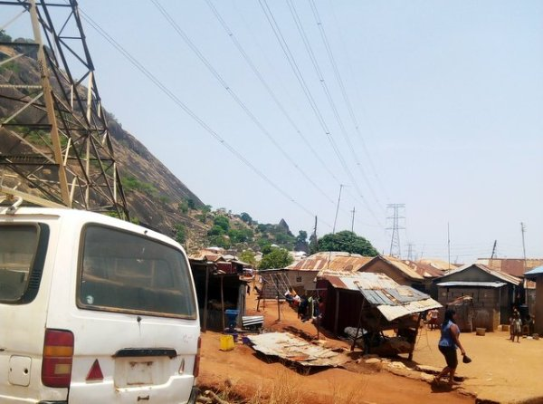 This is Dutse Alhaji in Abuja where residents live under TCN power lines and are billed by Abuja DisCo in a shabby power network