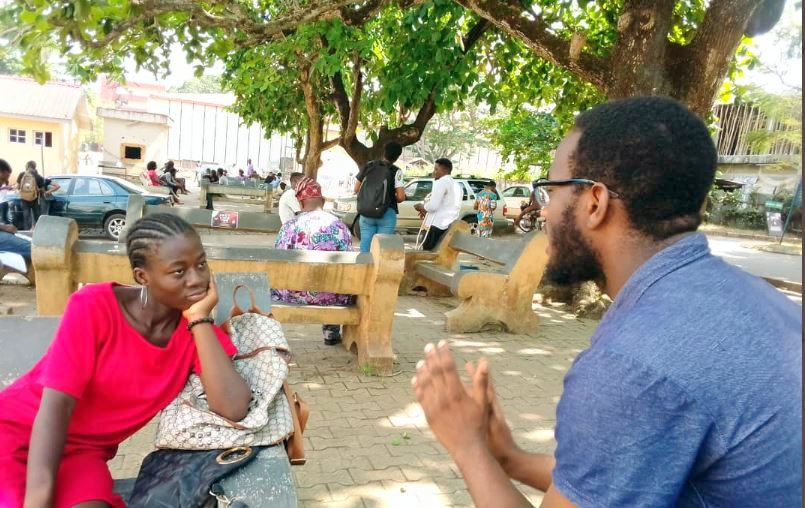 A Dubawa volunteer and a respondent having a heart-to-heart talk on fact-checking