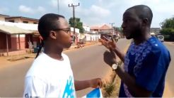 A Dubawa volunteer testing the knowledge of his respondent on fact-checking on the street of Idah, Kogi State