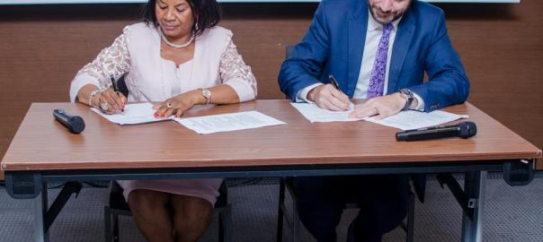 Chinyere Egwuonwu and Peter Sissons at the signing of the MoU