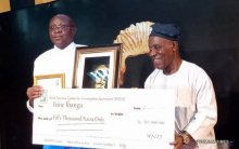 Ibanga Isine receiving the award