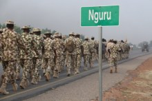 The officers marching into Nguru town