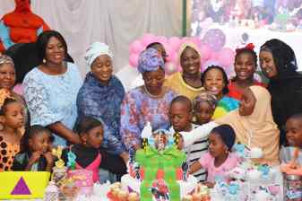 First Lady, Aisha Buhari represented by wife of the Speaker, House of Representatives, Salamatu Gbajabiamila welcome New Year Baby