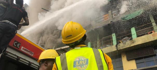 Operatives of the Lagos State Emergency Agency (LASEMA) putting off the fire.