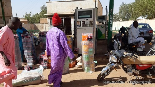 BORDER: Goods being arranged in sacks at now shut Forte Oil station, Illela, Sokoto State, for export to Niger through illegal route.