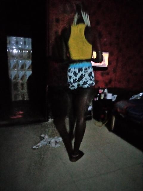 Adijat's back view in her room