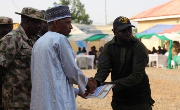 Idris Buba receiving his award from the Speaker Yobe State House of Assembly Ahmed Lawan Mirwa
