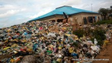 The abandoned PHC building with high heaps of dump before it was cleared