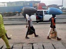 A commercial bus conveying passengers along Ikorodu road, Lagos.