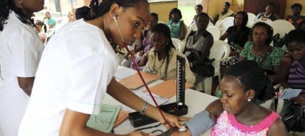 FILE: A nurse checks the blood pressure of a patient at National Hospital Abuja