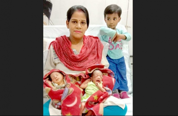 Mother Preeti Verma with her newborn twins. (Credit: EPS)