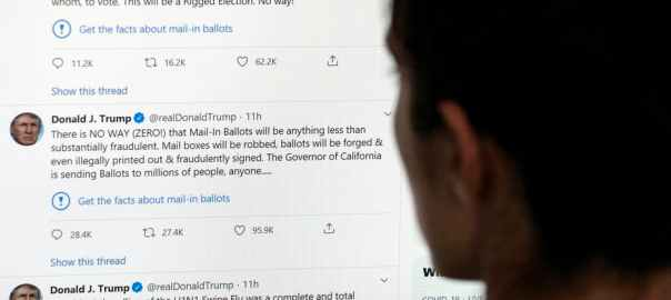 A user looks at President Donald Trump's tweets, and the Twitter-appended notice suggesting users 'get the facts.' AFP via Getty Images