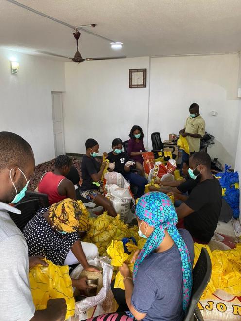 Tap Initiative distributes food materials.