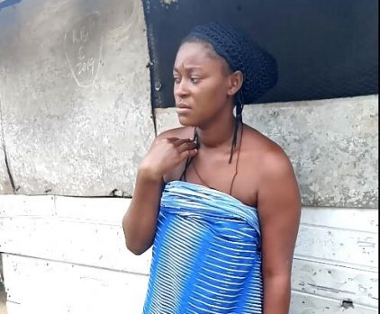 Josephine Oyibo in front of her house at Ifiekporo, Warri South Local Government Area