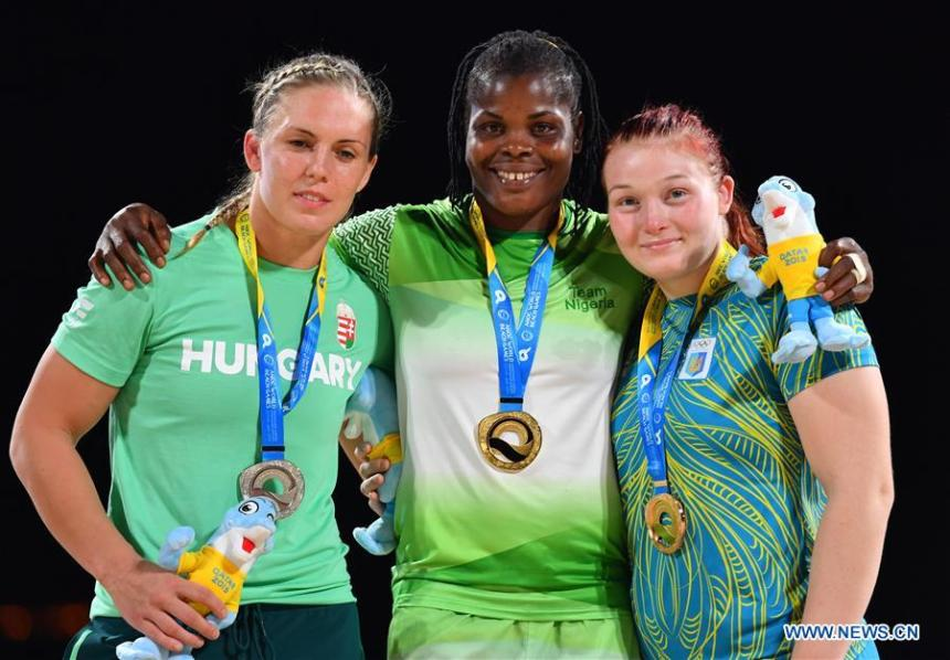 Gold medalist Blessing Joy Onyebuchi (C) of Nigeria pose for photos during the awarding ceremony of the women's Beach Wrestling Over 70kg at the 1st ANOC World Beach Games Qatar 2019 in Doha Photo Credit: Xinhua