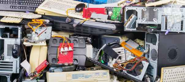 Electronic waste heap from used discarded computer parts and cases [Photo: The Conversation - Ladislav Kubes/Getty Images]