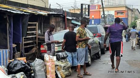 Commercial vehicles and touts conducting business at Jibowu Lagos in violation of the ban on interstate travels.