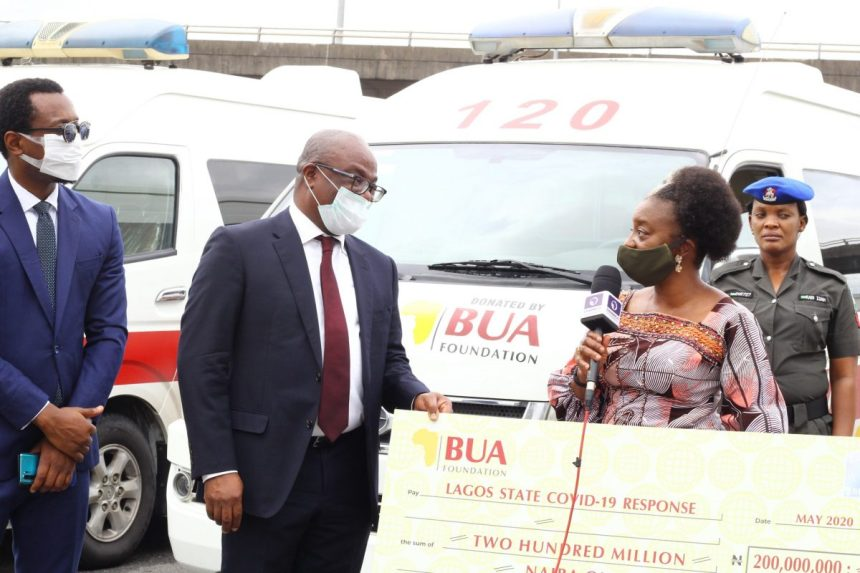 IMG_8929: L-R: O'tega Ogra, Group Head, Corporate Communications, BUA Group, Chimaobi Madukwe, Representative of BUA Foundation and Group Chief Operating Officer, BUA Group, Ibijoke Sanwo-Olu, First Lady of Lagos State at the presentation of 5 ambulances and N200 Million cash donation to the Lagos State COVID-19 Response.