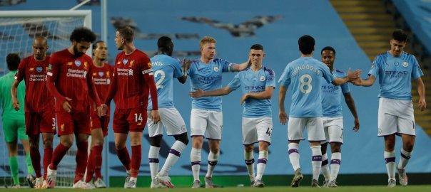 ManCity players celebrate after scoring a goal [PHOTO: @ManCity].