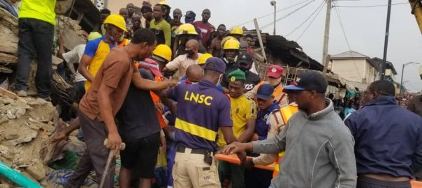 Officials of NEMA at the site of the collapsed building