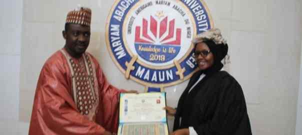 Maryam Damban receiving her award