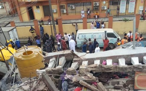 Officials search to rescue survivors at the building collapse site