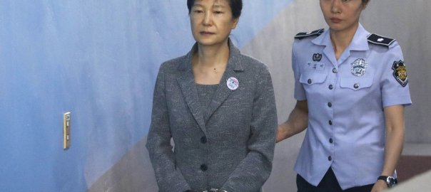 Park Geun-hye arriving in court a year ago. An appeals court added a year to the ousted South Korean president's prison term on Friday. [PHOTO: Pool photo by Kim Hong-Ji]