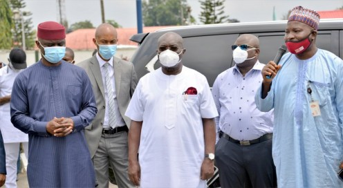 Representative of BUA, Ibrahim Lile, General Manager, BUA Ports and Terminals (Right) Governor Okezie Ikpeazu of Abia State (Middle) and other top government officials during the donation of 3 ambulances to help fight against the COVID-19 pandemic in the state at the Government House, Umuahia.