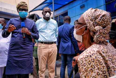 Lagos State Governor, Mr. Babajide Sanwo-Olu talking to one of the affected residents, Mrs. Johnson during his visit to the scene of helicopter crash at Opebi area of Ikeja, on Saturday, August 29, 2020. With him is Commissioner for Special Duties and Inter-governmental Relations, Mr. Tayo Bamgbose-Martins.