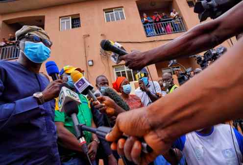 Lagos State Governor, Mr. Babajide Sanwo-Olu addressing residents and journalists during his visit to the scene of helicopter crash at Opebi area of Ikeja, on Saturday, August 29, 2020.