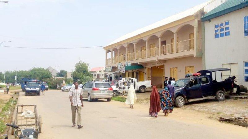 Police vehicles at Press Centre, Kano
